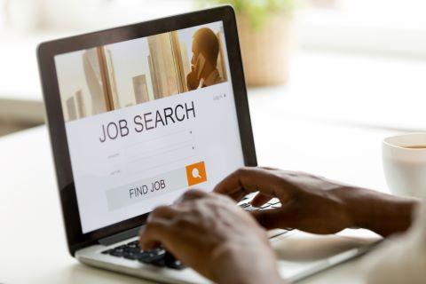 African-american man browsing work online using online job search application