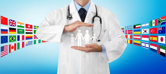 international travel medical insurance concept, doctor's hands protect a family icon, on blue background with flags